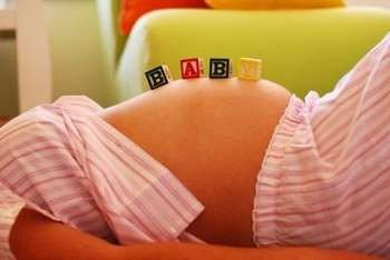Кубики на животе беременной
